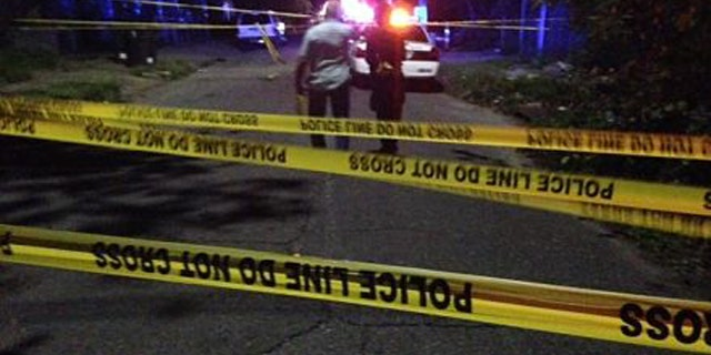 August 10, 2014: New Orleans police investigate a shooting in the city's Lower Ninth Ward that left two people dead and five others injured, including two young children. (Courtesy WVUE-TV)
