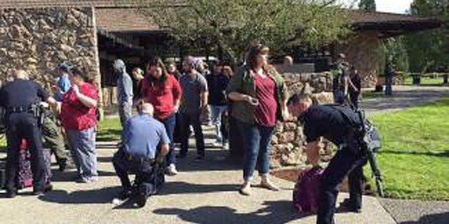 Cops worked to remove students from Umpqua Community College in Oregon.