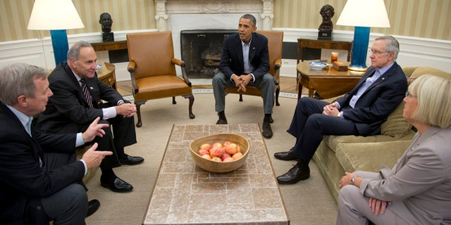 From left, Sen. Dick Durbin, D-Ill., Sen. Charles Schumer, D-N.Y., President Barack Obama, Senate Majority Leader Harry Reid of Nev., Sen. Patty Murray, D-Wash., meet in the Oval Office of the White House, Saturday, Oct. 12, 2013, in Washington. The federal government remains partially shut down and faces a first-ever default between Oct. 17 and the end of the month. (AP Photo/Carolyn Kaster)