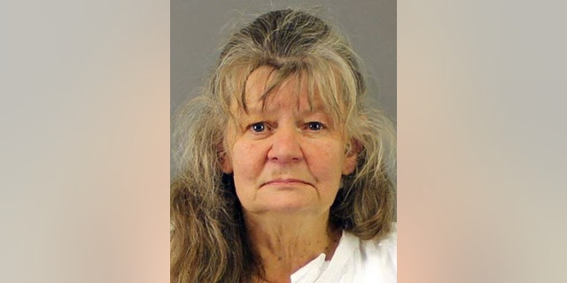 Deborah Leonard mug shot. Leonard and her husband, Bruce Leonard of Clayville, N.Y., were charged with first-degree manslaughter in the beating death of their 19-year-old son, Lucas. (New Hartford Police Department via AP)