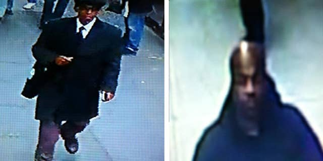 This image provided by the New York City Police Department shows surveillance video images the two men who are suspected of robbing a New York City jewelry store at gunpoint in broad daylight Tuesday Nov. 11, 2014. Deputy Chief of Detectives William Aubry says one of the store's co-owners was pistol whipped by one of the suspects and suffered minor injuries. (AP Photo/New York City Police Department)