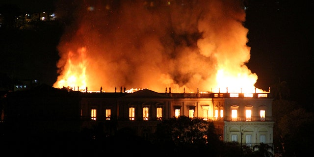 Flames tearing through the 200-year-old National Museum of Brazil in Rio de Janeiro on Sunday.