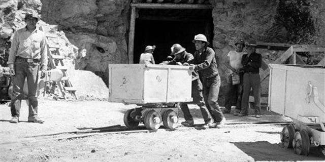 In this May 7, 1953, file photo, Navajo miners work at the Kerr McGee uranium mine at Cove, Ariz., on the Navajo reservation in Arizona.