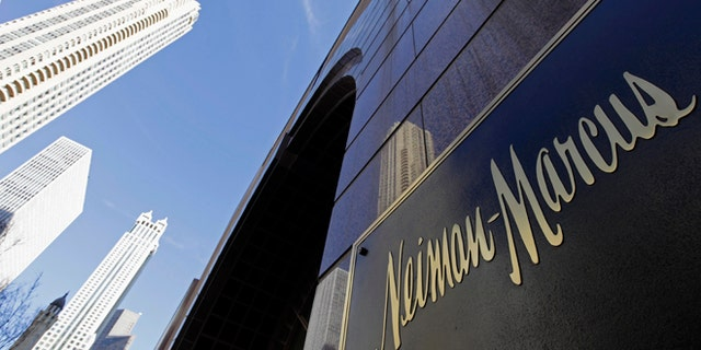 The Chicago skyline is reflected in the exterior of Neiman Marcus on Michigan Avenue.