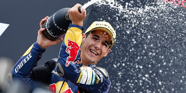 FILE, In this Saturday June 29 2013 file photo, Luis Salom of Spain celebrates his victory during the podium ceremony of the Moto3 race of the Dutch Grand Prix in Assen, northern Netherlands. MotoGP officials say Moto2 rider Luis Salom has died after crashing during practice for the Catalunya Grand Prix on Friday. He was 24. The death was announced at a news conference at the Barcelona circuit. (AP Photo/Vincent Jannink, File)
