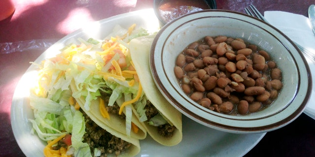 In this Sept 5, 2013 photo, a soft taco plate from El Patio de Albuquerque is shown. El Patio is a longtime, unpretentious eatery near Albuquerqueâs University of New Mexico campus, and is one of the cityâs most popular dining spots. For nearly four decades, multi-generational families, tourists, professors, students _ even celebrities _ have lined up outside this former house for robust but simple fare.  (AP Photo/Russell Contreras)