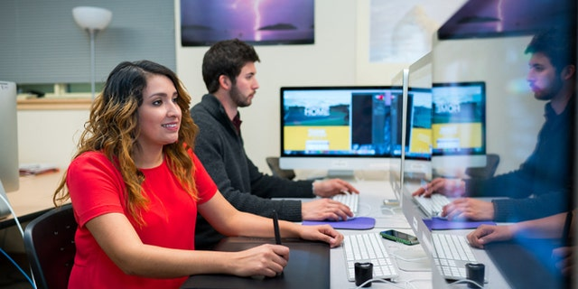 In this November 2015 photo provided by Western New Mexico University shows student Grecia Rivas works in a computer lab on campus in Silver City, N.M. The school in recent months have launched an aggressive campaign aimed at attracting students like Rivas, high-achieving immigrants living in the country illegally but who have been granted temporary status under the Obama Administration. (Jay Hemphill/Western New Mexico University via AP)