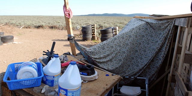An improvised bathroom stands inside a squalid makeshift living compound in Amalia, New Mexico, on Friday.