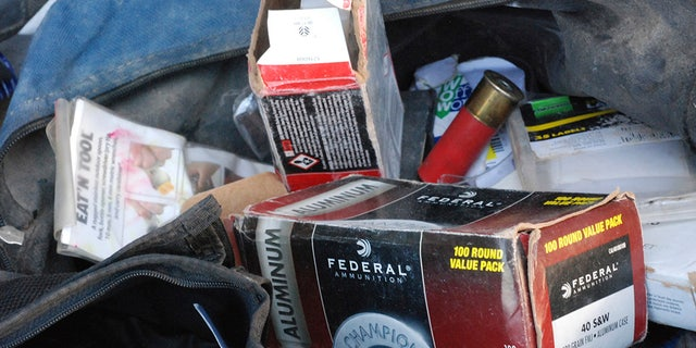 Ammunition for firearms was left behind at a squalid makeshift living compound in Amalia, New Mexico, on Friday,