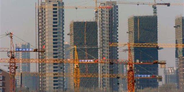 """A housing development under construction in Shenyang, China, in 2009. """"Ghost cities"""" have sprung up around the country as developers struggle to fill units."""