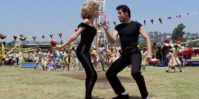 "John Travolta and Olivia Newton-John filming ""Grease."""