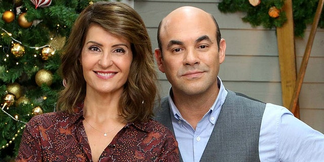 """Nia Vardalos and her husband, actor Ian Gomez, have annouced that they are getting a divorce after 25 years of marriage. Here the pair pose on set of """"The Great American Baking Show"""" which the co-hosted together."""
