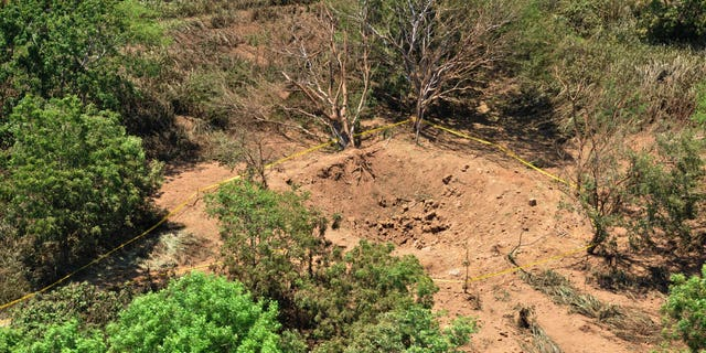 Sept. 7, 2014: An impact crater made by a small meteorite in a wooded area near Managua's international airport and an air force base.