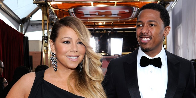 Singer-actress Mariah Carey and TV personality Nick Cannon attend the 20th Annual Screen Actors Guild Awards at The Shrine Auditorium on January 18, 2014 in Los Angeles, California.