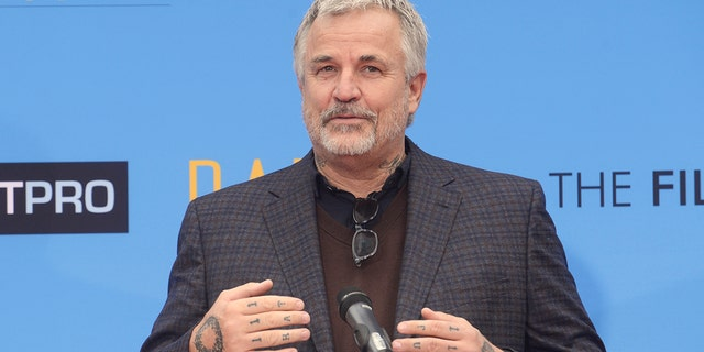 Nick Cassavetes speaks at a ceremony where Rowlands places hand and footprints in the forecourt of the TCL Chinese Theatre in Los Angeles December 5, 2014.