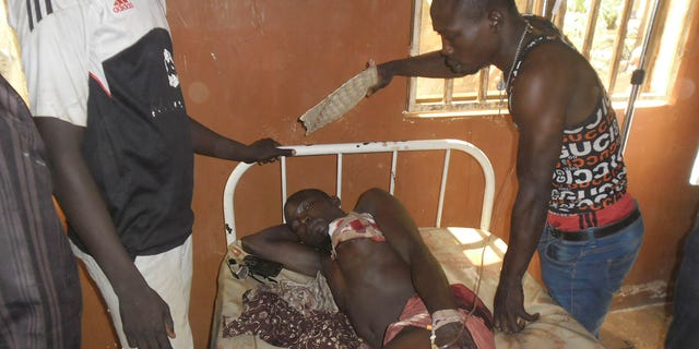 May 8, 2015 - A student wounded during a suicide bomb attack at the College of Administrative and Business Studies receives treatment at a hospital in Potiskum, Nigeria. Nigeria's military says it has destroyed 10 Boko Haram camps, killed many militants and captured heavy weaponry in the northeastern Sambisa Forest.