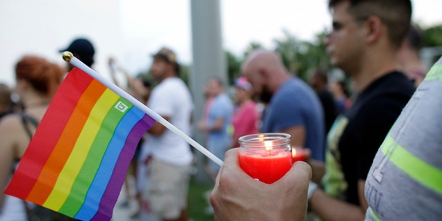 A vigil in memory of the victims of the Orlando mass shooting, Sunday, June 12, 2016, in Miami Beach, Fla.