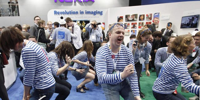 Feb. 27, 2012: Nokia staff dance after the presentation of the new Lumia 900 after a news conference during the Mobile World Congress in Barcelona.