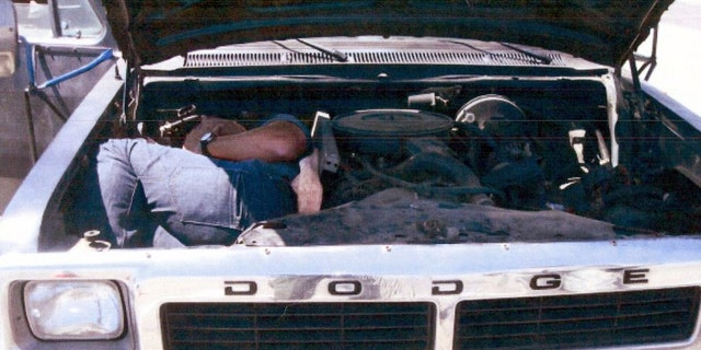 This undated image provided by the U.S. Immigration and Customs Enforcement (ICE) shows an individual smuggled inside the engine compartment discovered at the U.S. border. Five people were indicted Thursday Feb. 2, 2012 in connection with an alleged human smuggling ring that used non-Spanish-speaking, African-American drivers to shuttle illegal immigrants from the border in a bid to elude detection, authorities said.(AP Photo/ICE)