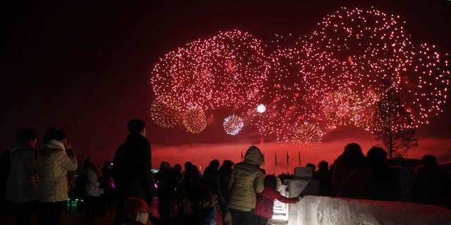 People in North Korea watch New Year's Day fireworks in Pyongyang.