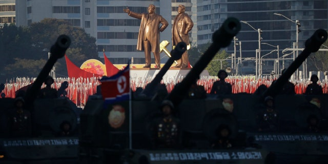 Oct. 10, 2015: Statues of Kim Il Sung and Kim Jong Il stand above soldiers during a military parade in Pyongyang, North Korea. (AP Photo/Wong Maye-E)