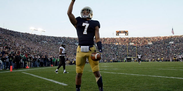 Nov. 17, 2012: Notre Dame Fighting Irish wide receiver TJ Jones (7) celebrates after making a touchdown catch against Wake Forest Demon Deacons during the first half of their NCAA college football game at Notre Dame Stadium in South Bend, Indiana. (Reuters)