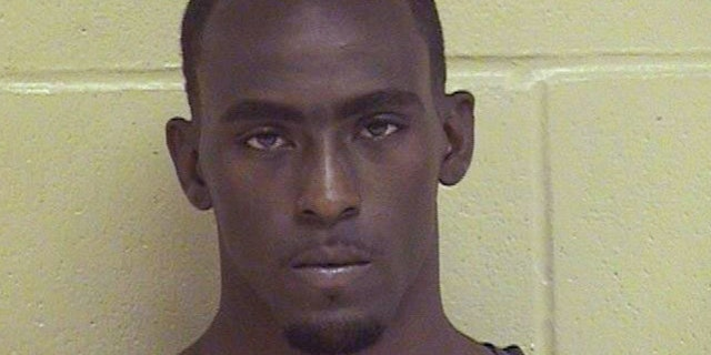 This undated booking photo released by the Shreveport Police Department shows Grover Cannon, named as a suspect in the shooting death of Shreveport police officer Thomas LaValley, Wednesday, Aug. 5, 2015. LaValley, 24, was shot multiple times while answering a call about a suspicious person at a home in the city's Queensborough neighborhood, according to police. (Shreveport Police Department via AP)