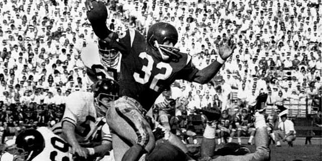 Nov. 9, 1968: FILE - Southern California's O.J. Simpson tries to break a California tackle as he picks up five yards at the Los Angeles Memorial Coliseum. Los Angeles police said in a statement Tuesday they've recovered a Heisman Trophy honoring O.J. Simpson more than 20 years after it was stolen from the University of Southern California. (AP Photo/File)