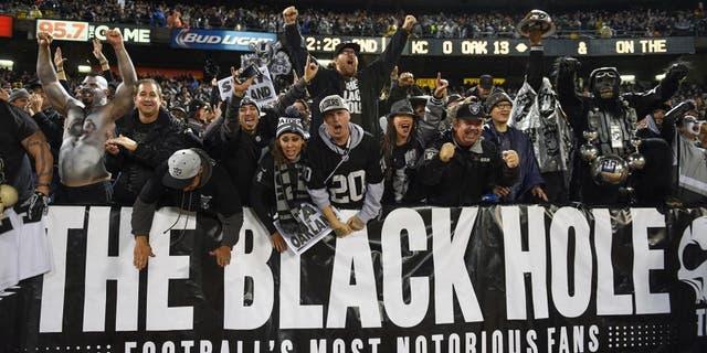November 20, 2014; Oakland, CA, USA; Oakland Raiders fans celebrate during the second quarter against the Kansas City Chiefs at O.co Coliseum. Mandatory Credit: Kyle Terada-USA TODAY Sports