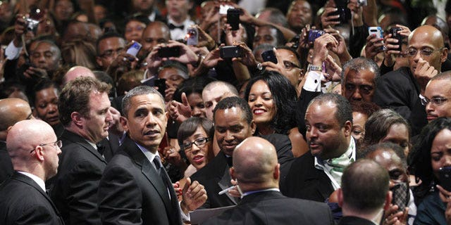 September 24: President Barack Obama turns around looking for first lady Michelle Obama as he greets the crowd at the Congressional Black Caucus Foundation Annual Phoenix Awards in Washington.