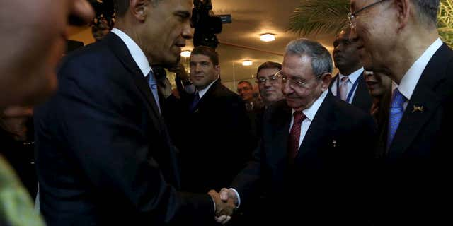 April 10, 2015: U.S. President Barack Obama (L) and his Cuban counterpart Raul Castro shake hands as U.N. Secretary General Ban Ki-moon (R) looks on, before the inauguration of the VII Summit of the Americas in Panama