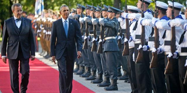 September 3, 2014: U.S. President Barack Obama and Estonian President Toomas Hendrik Ilves review the honor guard at Kadriorg Palace in Tallinn. (AP Photo/Charles Dharapak)