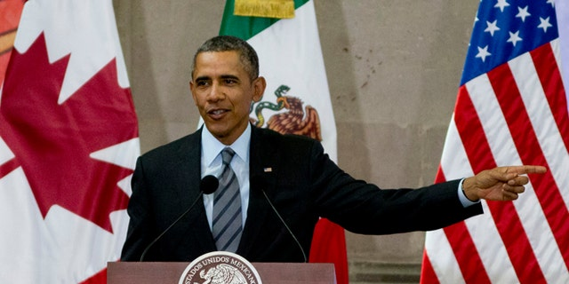 President Barack Obama speaks during a news conference at the end of the North American Leaders Summit in Toluca, Mexico, Wednesday, Feb. 19, 2014. The leaders of the three North American Free Trade Agreement (NAFTA) nations met in part to highlight the economic cooperation that has grown since NAFTA joined the U.S., Canada and Mexico 20 years ago. (AP Photo/Eduardo Verdugo)
