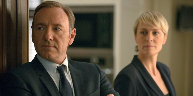"This image released by Netflix shows Kevin Spacey as Francis Underwood, links, and Robin Wright as Clair Underwood in a scene from ""House of Cards."" (AP Photo/Netflix, Nathaniel E. Bell)"