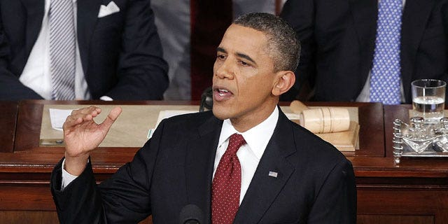 January 24, 2012: President Barack Obama delivers the State of the Union address as Vice President Joe Biden and House Speaker John Boehner of Ohio listen in the U.S. Capitol in Washington.