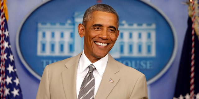 In this Thursday, Aug. 28, 2014 file photo, President Barack Obama in the James Brady Press Briefing Room of the White House in Washington.
