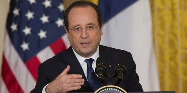 February 11, 2014: French President François Hollande speaks during a joint news conference with President Barack Obama, as part of an official state visit in the East Room of the White House in Washington.  (AP Photo/ J. Scott Applewhite)
