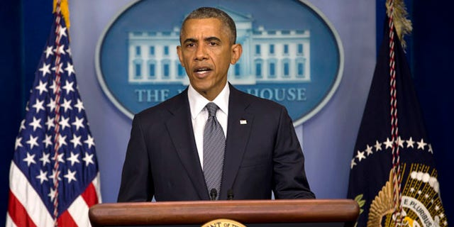 President Barack Obama speaks about the situation in Ukraine, Friday, July 18, 2014, in the Brady Press Briefing Room of the White House in Washington.