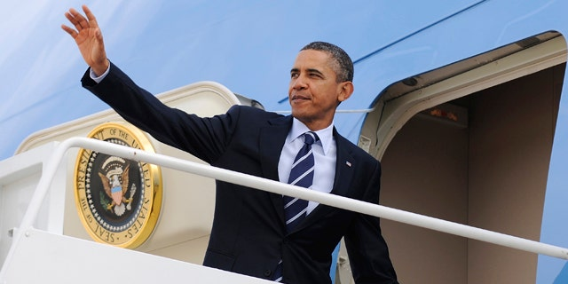 U.S. President Barack Obama waves as he boards Air Force One to depart for a trip to Pennsylvania and Florida, from Joint Base Andrews, Maryland, October 11, 2011.  REUTERS/Jonathan Ernst    (UNITED STATES - Tags: POLITICS)