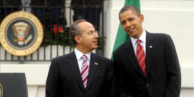 Thursday: President Obama poses for photos with Mexican President Felipe Calderon.