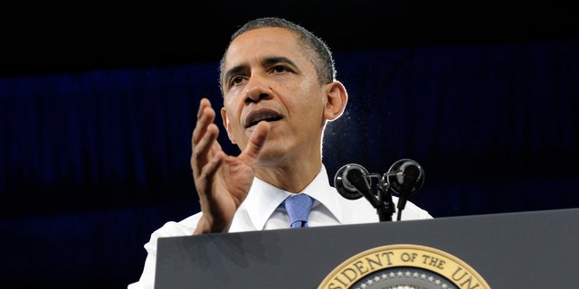 President Barack Obama speaks at the University of Miami Field House in Coral Gables, Fla., Thursday, Feb. 23, 2012. (AP Photo/Susan Walsh)