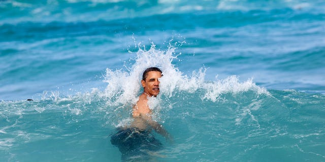 President Barack Obama, daughters Sasha and Malia, and and friends swim at Pyramid Rock Beach at Marine Corps Base Hawaii, Kaneohe Bay, Hawaii, Jan. 1, 2012.  (Official White House Photo by Pete Souza)