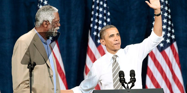Sept. 25: President Barack Obama is introduced by NBA basketball hall-of-famer Bill Russell during a Democratic fundraiser at the Paramount Theater.