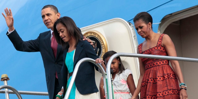 March 19: President Obama and the First Family emerge from Air Force One after arriving in Brasilia, Brazil.