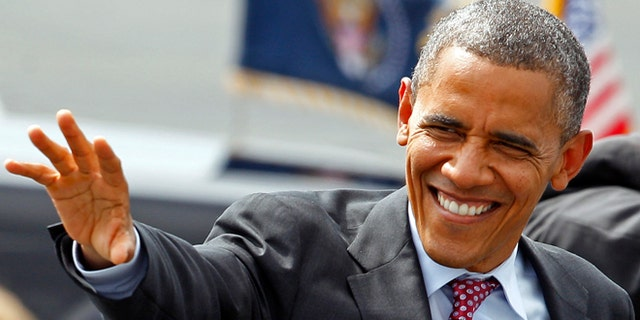President Barack Obama waves to supporters as he arrives at the Charlotte/Douglas International Airport for the Democratic National Convention in Charlotte, N.C., Wednesday, Sept. 5, 2012. (AP Photo/Chuck Burton)