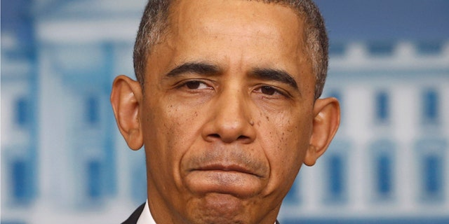 FILE: Nov. 14, 2013: President Obama in the Brady Press Briefing Room of the White House, in Washington, D.C.