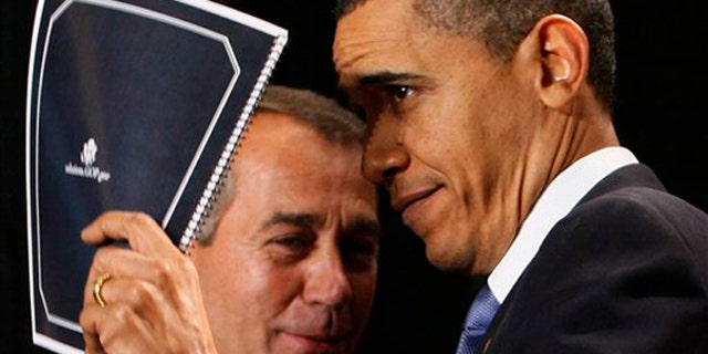 President Barack Obama holds up a document of Republican solutions given to him by House Minority Leader John Boehner of Ohio, before he spoke to Republican lawmakers at the GOP House Issues Conference in Baltimore, Friday, Jan. 29, 2010. (AP Photo/Charles Dharapak)