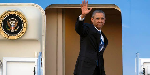 July 23, 2015: President Barack Obama waves as he boards Air Force One for a trip to Kenya and Ethiopia. Obama is the first sitting U.S. president to visit both countries. (AP Photo/Cliff Owen)