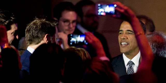 Sept. 27, 2015: President Barack Obama greets members of the crowd after speaking at a Democratic National Committee LGBT fundraising gala at Gotham Hall in New York. (AP Photo/Andrew Harnik)