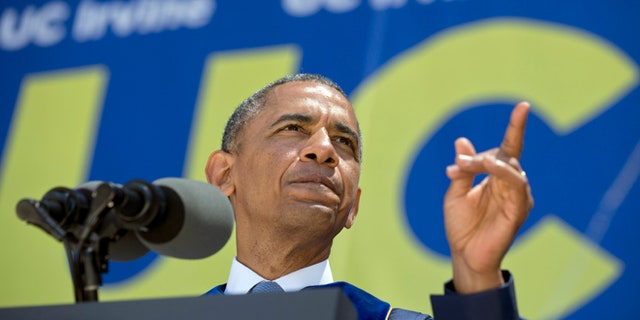 June 14,  2014: President Obama talks to the graduating class of the University of California, Irvine, at Angel Stadium in Anaheim, Calif.
